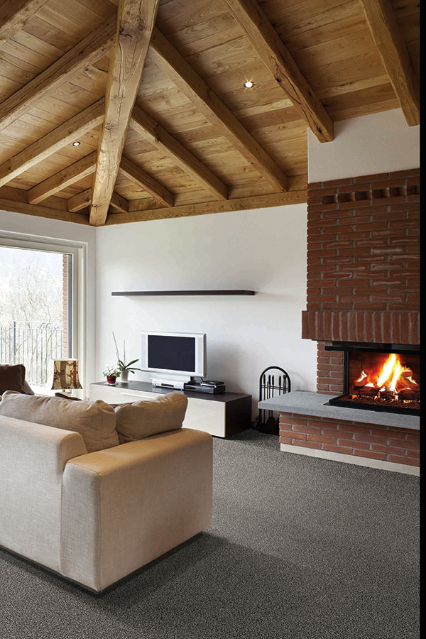 living room with wooden beam ceiling