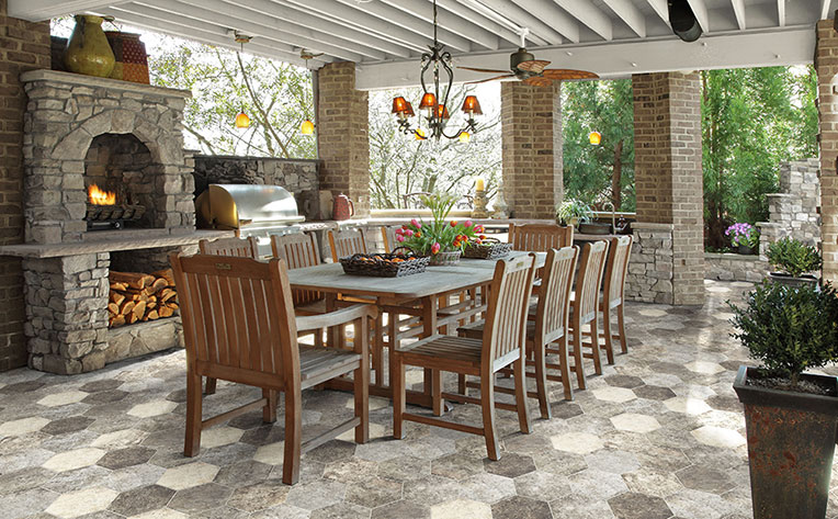 Outdoor covered dining space with stone fireplace